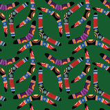 Boomerang Seamless Pattern. Seamless pattern with boomerangs on green background Vector Illustration