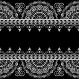 Seamless pattern border elements with flowers and lace lines. In Indian mehndi style  on black background. Vector illustration Royalty Free Stock Image