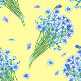 Seamless pattern with the bouquets of blue forget-me-not flowers (Myosotis), painted in a watercolor on a yellow background Royalty Free Stock Photo