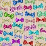Seamless pattern with bow tie on beige striped background royalty free illustration