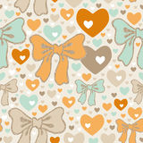 Seamless pattern with bows and hearts.  Stock Images
