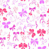 Seamless pattern with bows. Pink bows on white background. Stock Photos