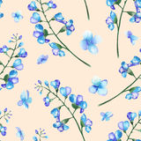 Seamless pattern with the branches of blue flowers (bluebell), painted in a watercolor on a pink background Royalty Free Stock Photos