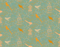 Seamless pattern with branches, thorns, birds and vintage birdcage. Royalty Free Stock Photo