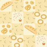 Seamless pattern with bread, croissants, bread rings, cake and candy Royalty Free Stock Photos