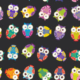 Seamless pattern - bright colorful owls on black Royalty Free Stock Photos