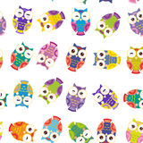 Seamless pattern - bright colorful owls on white Stock Photos