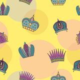 Seamless pattern with bright graceful crowns on a yellow backgro Stock Image
