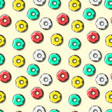 Seamless pattern of bright multi-colored donuts Royalty Free Stock Images