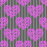 Seamless pattern with bright pink hearts on a stri Royalty Free Stock Photos