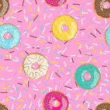 Seamless pattern bright pink tasty vector donuts and sprinkles background in cartoon style for menu in cafe and shop. Royalty Free Stock Image