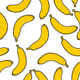 Seamless pattern with bright scattered doodle bananas. Retro Royalty Free Stock Images