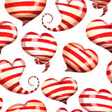 Seamless pattern of bright, striped hearts on a Royalty Free Stock Photo