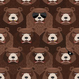 Seamless pattern of brown angry bear. A flock of evil and scary Stock Photos