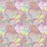 Seamless pattern with brown hearts on the background of hearts in different colors. Royalty Free Stock Photography