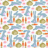 Seamless pattern with bunnies, flowers, carrots and cabbage. Rabbit background for kids. Stock Images