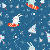 Seamless pattern of bunnies on snowboards Stock Images
