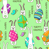 Seamless pattern of bunny rabbits holding Easter eggs Royalty Free Stock Photo