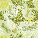Seamless pattern with butterflies. Dragonflies, and abstract flowers Stock Images