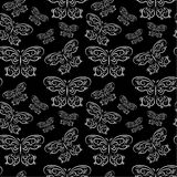 Seamless pattern with butterflies on a black background Royalty Free Stock Photos