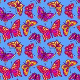 Seamless pattern with butterflies on blue Stock Photos