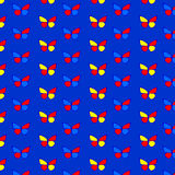 A seamless pattern with butterflies on a dark blue background Royalty Free Stock Image