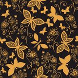 Seamless pattern with butterflies and flowers. Stock Photos