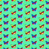 A seamless pattern with butterflies on a light green background Stock Image