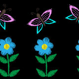 Seamless pattern with butterfly and flower embroidery stitches i Stock Photo