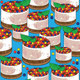 Seamless pattern cake on blue Stock Photography