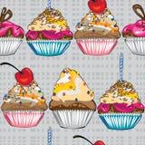 Seamless pattern cake on gray Royalty Free Stock Photos