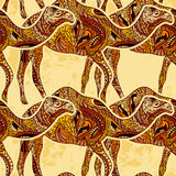 Seamless pattern with camel decorated with oriental ornaments on grunge background. Vintage colorful hand drawn vector illustration Royalty Free Stock Photography