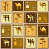 Seamless pattern with camels and palm trees Stock Images