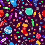 Seamless pattern of candies and Christmas symbols Stock Photos