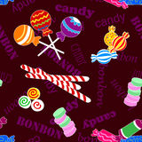 Seamless pattern of candy and bonbon. Fun seamless pattern made of all kinds of colorful candy including lollipops over dark background with candy and bonbon Stock Photography