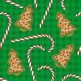 Seamless Pattern. Candy Cane and Gingerbread. Seamless Pattern with Christmas Candy Cane and Gingerbread Christmas Tree on a Green Plaid Background Royalty Free Stock Image
