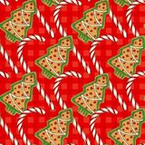 Seamless Pattern. Candy Cane and Gingerbread. Seamless Pattern with Christmas Candy Cane and Gingerbread Christmas Tree on a Red Plaid Background Royalty Free Stock Photos