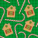 Seamless Pattern. Candy Cane and Gingerbread. Seamless Pattern with Christmas Candy Cane and Gingerbread House on a Green Plaid Background Royalty Free Stock Images