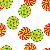 Seamless pattern candy stripe. Candy on a stick.Three multi-colored treats. Glossy, delicious, festive striped candy canes.Vector image of Christmas sweets.The Royalty Free Stock Photo