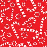 Seamless pattern with candycanes and stars Royalty Free Stock Photo