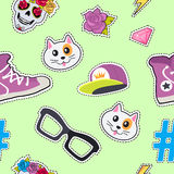 Seamless Pattern with Cap, Cat, Glasses, Thunder. Male rap cap, sport footwear, muzzle of cat, glasses, thunder sign, sticker, diamond, brilliant, hashtag, skull Royalty Free Stock Photography