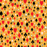 Seamless pattern with card suits on a yellow backg. Round Stock Image