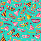 Seamless pattern with carnival masks and text Royalty Free Stock Photo