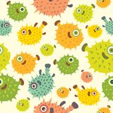 Seamless pattern with cartoon balloon fish. Vector seamless pattern with color ballon fish on a yellow background. Cartoon wallpaper with pufferfish Royalty Free Stock Photo