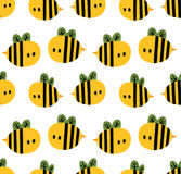 Seamless pattern with cartoon bees for design fabric, backgrounds, wrapping paper Royalty Free Stock Image