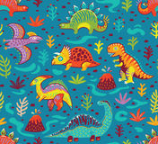 Seamless pattern with cartoon dinosaurs. Dinosaurs seamless pattern in cartoon style. Prehistoric period. Vector illustration. The background is made in blue Royalty Free Stock Image