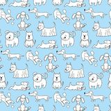 Seamless pattern with cartoon dogs on the blue background. Vector illustration Royalty Free Stock Photos