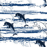 Seamless pattern with cartoon dolphins. Stock Photography