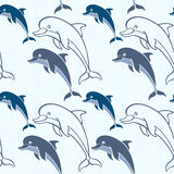 Seamless pattern with cartoon dolphins. Royalty Free Stock Photo