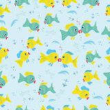 Seamless pattern with cartoon fishes Stock Photos
